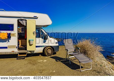 Wild Camping On Sea Shore. Camper Car Rv With Clothes Hanging To Dry. Holidays With Motor Home.