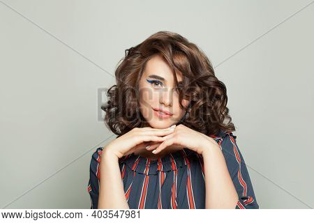Happy Fashion Model Woman With Curly Hairdo On White Background