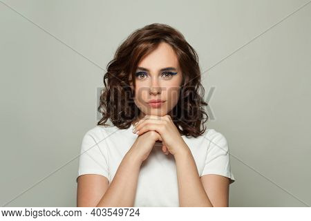 Pretty Fashion Model Woman With Curly Hairdo On White Background