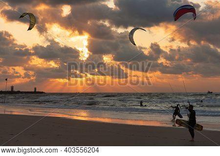 Scheveningen, The Netherlands - September 29, 2008: Kite Surfing In The Sunset At The Beach Of Schev