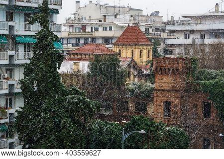 Thessaloniki, Greece - January 16 2019: Heavy Snowfall At The City Center. Snow Falling On Residenti