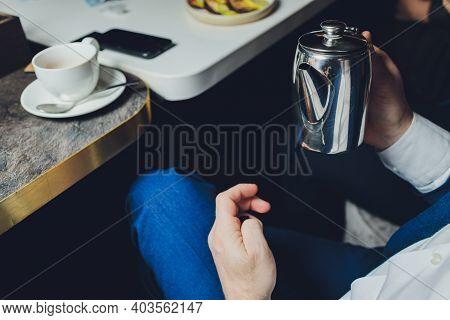 Close Up Man Pouring Hot Tea From Teapot Into Small Glass Near Window.process Brewing Tea, Tea Cerem