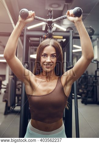 Fitness Woman Pumping Up Triceps Muscles Workout Fitness And Bodybuilding Concept Gym Background Exe