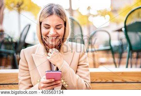 Happy Millenial Woman Smiling Over Open Face Mask After Lockdown Reopening - New Normal Technology C