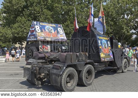 Sevastopol, Crimea, Russia - July 26, 2020: Cars Of The Bike Club Night Wolves With Advertising For