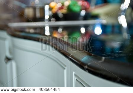 Perspective View Of Polished Granite Countertop, Table Top With Bokeh Background. Stone Slab Used Fo