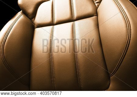 Modern Luxury Car Brown Leather Interior. Part Of Orange Perforated Leather Car Seat Details With Wh
