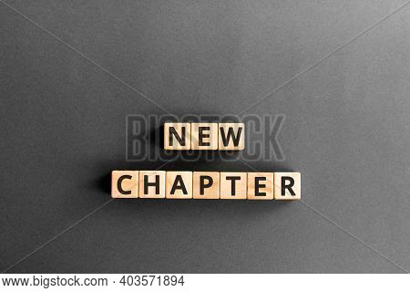 New Chapter - Words From Wooden Blocks With Letters, Starting New Life New Chapter Concept,  Grey Ba