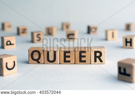 Queer - Word From Wooden Blocks With Letters, A Gay Person Unusual Or Strange Queer Concept, Random