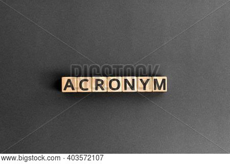 Acronym - Word From Wooden Blocks With Letters, Use Of Acronyms In The Modern World Abbreviation Con