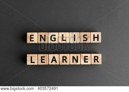 English Learner - Phrase From Wooden Blocks With Letters, Student  English Learner Concept, Top View