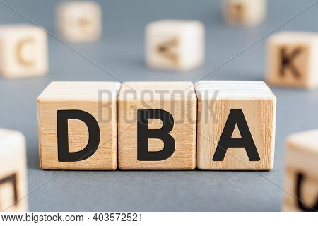 Dba - Acronym From Wooden Blocks With Letters, Database Administrator Or Doing Business As Abbreviat