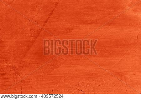 Dark Orange Modern Stylish Background With Place For Text. Uneven Wall With Terracotta Plaster. Empt