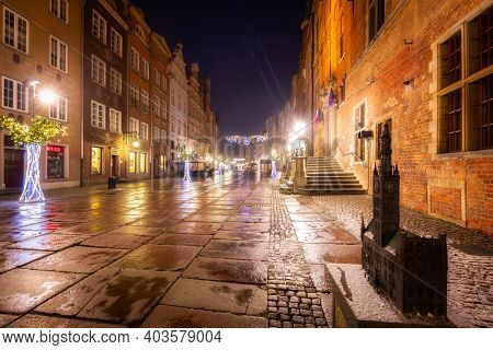 Gdansk, Poland - January 2, 2021: Christmas decorations in the old town of Gdansk at night, Poland