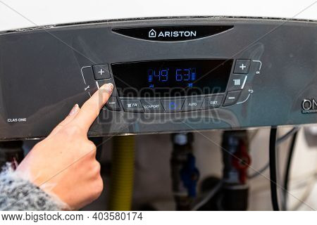 Girl Hand Setting Temperature To Heating System. Central Heating Control Panel. Settings For Tempera