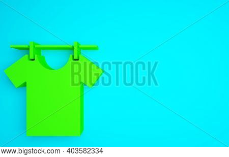 Green Drying Clothes Icon Isolated On Blue Background. Clean Shirt. Wash Clothes On A Rope With Clot