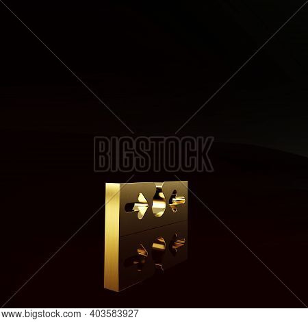 Gold Acne Icon Isolated On Brown Background. Inflamed Pimple On The Skin. The Sebum In The Clogged P