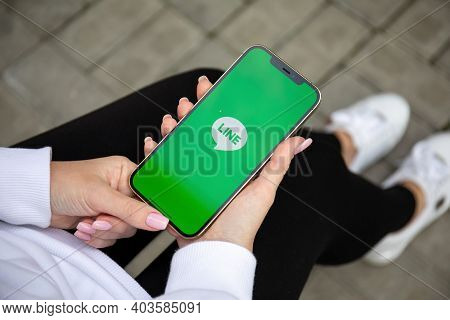 Alanya, Turkey - December 3, 2020: Woman Hand Holding Iphone 12 Pro Max Gold With Social Networking
