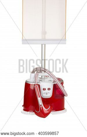Vertical Steam Iron For Clothes Isolated White Background With Clipping Path.