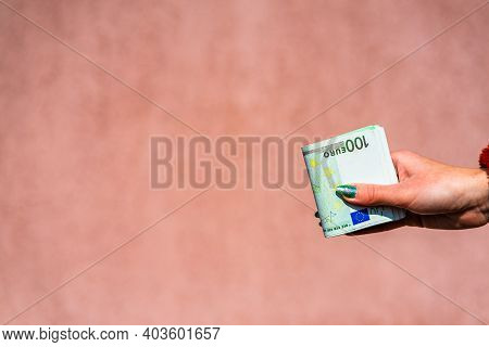 Hand Holding Showing Euro Money Or Giving Money Like Bribe Or Tips.100 Euro Banknotes Eur Currency I