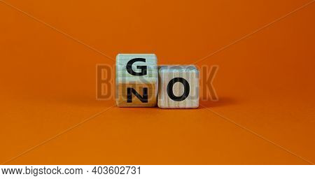No Or Go Symbol. Turned A Cube, Changed The Word 'no' To 'go'. Beautiful Orange Background. Copy Spa