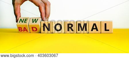 New Vs Bad Normal Symbol. Businessman Turns Wooden Cubes And Changes Words 'bad Normal' To 'new Norm
