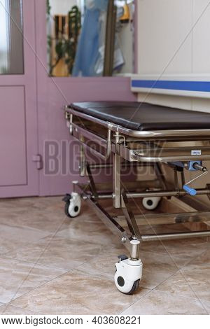 Empty Mechanical Trolley For Patients In The Hospital Corridor. Ambulance Trolley. Trolley For Trans
