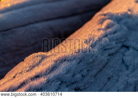 Wood Covered In A Hoar Frost During Sunrise On A Winter Morning.