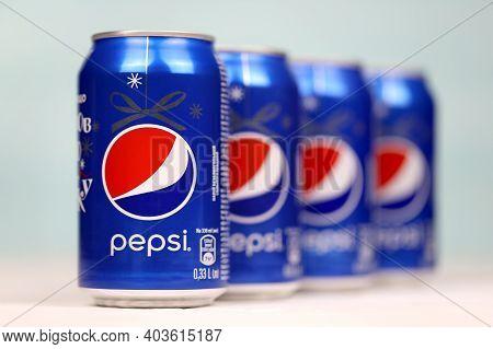 Kharkov, Ukraine - December 8, 2020: Aluminium Cans Of Pepsi Soft Drink On White Wooden Table. Pepsi