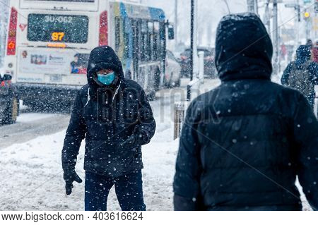 Montreal, Ca - 16 January 2021: Man With Face Mask For Protection From Covid-19 Walking Down The Str