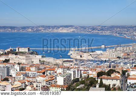 Aerial View Of Vieux Port Of Marseille With The Fort Saint-jean, The Palais Pharo And The Fort Saint