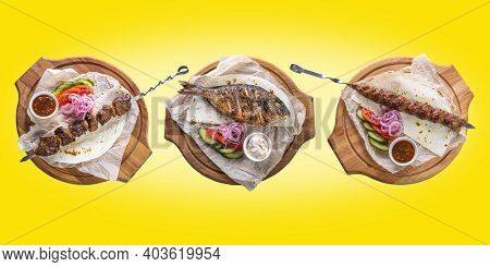 Three Dishes: Kebab, Grilled Dorado And Pork Kebab On A Yellow Isolated Background. The Concept Of R