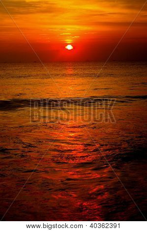 Sunset Reflecting In Ocean