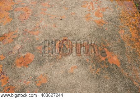 The Numbers On The Dirty Concrete Floor. No. 110 M.