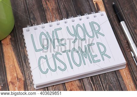 Love Your Customer, Text Words Typography Written On Book Against Wooden Background, Life And Busine