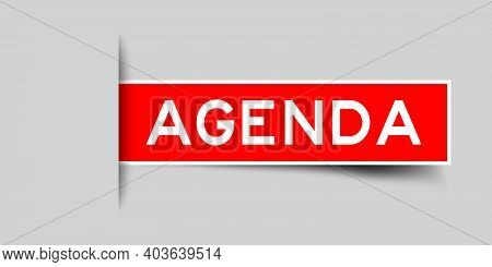 Inserted Red Color Label Sticker With Word Agenda On Gray Background
