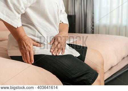 Hip Pain Of Senior Woman At Home, Healthcare Problem Of Senior Concept