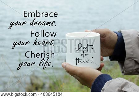 Inspirational Words - Embrace Your Dreams. Follow Your Heart. Cherish Your Life. With Person Holding
