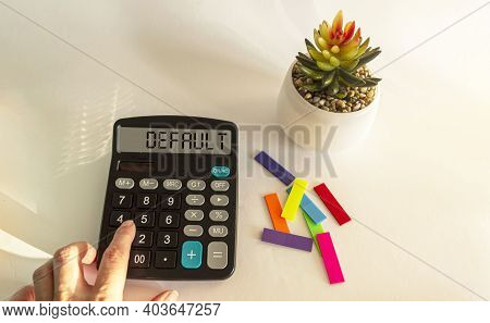 By Default, The Text Is Written On The Calculator Display. Female Hand Lies On Calculator, White Bac