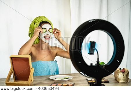 Young Female Vlogger Applying Skincare Facial Mask While Streaming Live For Web Channel At Home - Ha