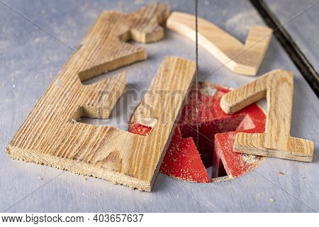 Cutting Wood With A Table Jigsaw. Cutting Complex Shapes In A Wooden Board.