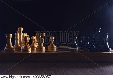 Old Chess Board With Figures From The Soviet Union Era On A Black Background. Chess Debut Sicilian D