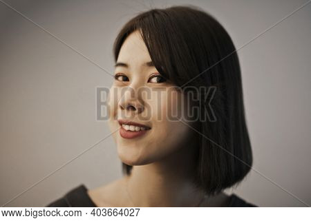 portrait of smiling young asian woman