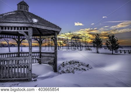 Snow Covered Gazebo In The Park On A Winter Evening. Christmas And Happy New Year Concept. Winter In