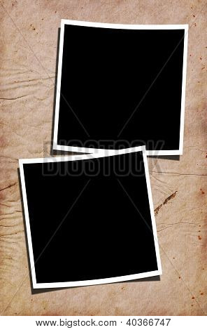 Blank Photographs On Stained Paper Background