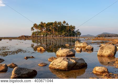 Small Island In Tropical Sea Sunset Or Sunrise Time At Low Tide Day.