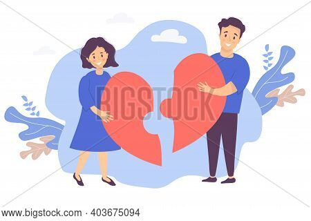 Couple Puts Together A Puzzle Of Halves Of The Heart. A Man And A Woman Reunite By Joining Two Piece
