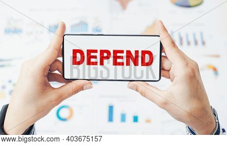 Close Up On Businessman Holding Smartphone With Depend Text.