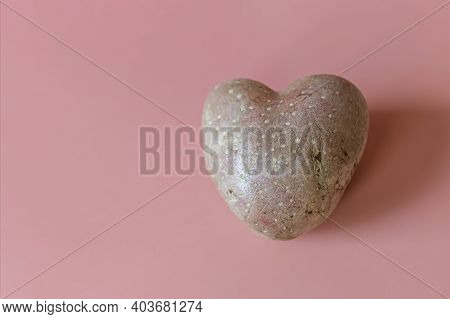 Genetically Modified Food, Heart Shaped Potatoes On A Pink Background. Products Of Modern Agricultur