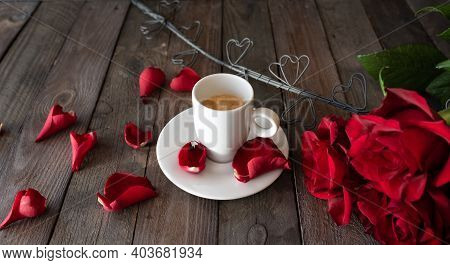 Cup Of Coffee With Red Roses And Hearts On Dark Vintage Planks. Breakfast Background For Valentines